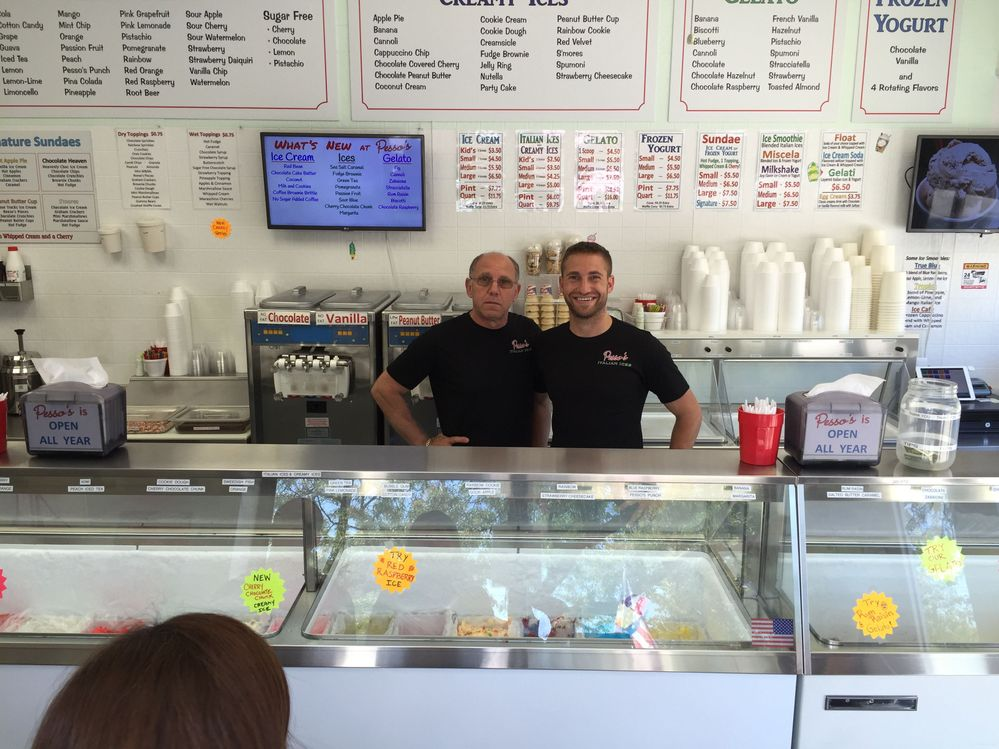 Pesso with his dad behind the counter